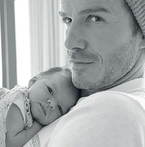 David Beckham and his 4th child and first daughter..Such a joyful picture..