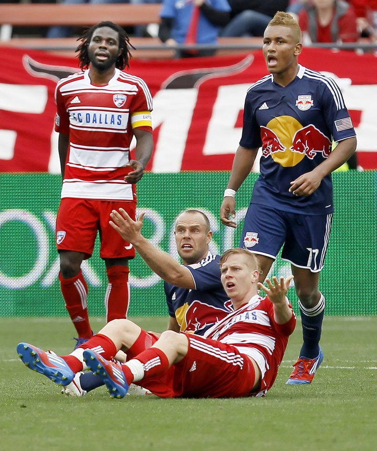 Brek Shea #20 of the FC Dallas and Joel Lindpere #20 of the New York Red Bulls look for a call from the referee as their teammates Ugo Ihemelu #3 of the FC Dallas and Juan Agudelo #17 of the New York Red Bulls during the first half of a soccer game at FC Dallas Stadium on March 11, 2012 in Frisco, Texas.