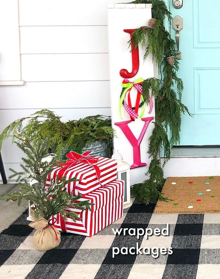 Joy To The World Holiday Porch Bright Colors A Giant Sign Snowball Wreath And Hand Painted Rug Create Hy Welcome For Family Friends With