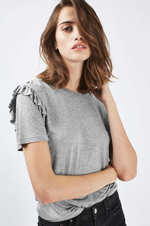 Update your basics with this grey marl t-shirt featuring a chic frill shoulder detail. The perfect throw-on with your favourite boyfriend jeans.