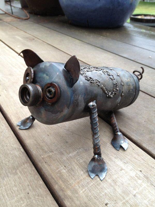 Scrap Metal Pig Garden Art. $35.00, via Etsy.