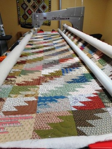 WOW! Set diagonally! This is a great way to set Scrappy Mountain Majesties free pattern by Bonnie Hunter.
