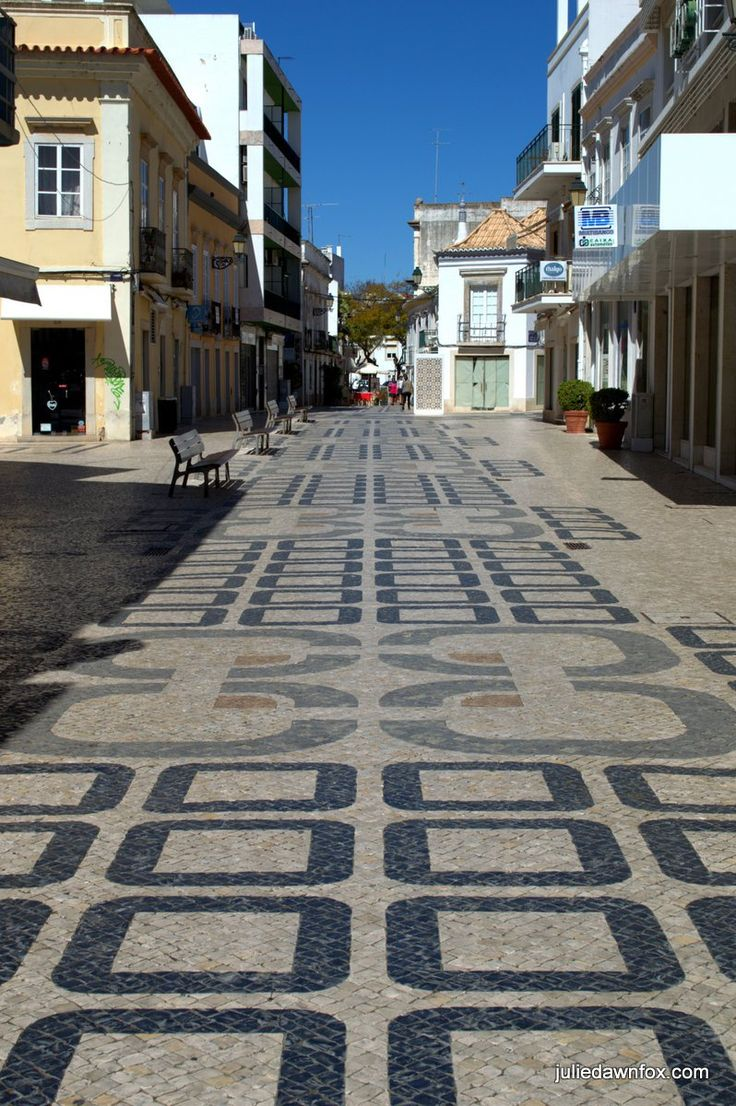 Squares. Patterned cobbled streets in downtown Faro in the Algarve region of Portugal