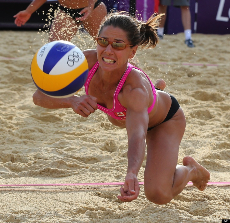 Annie Martin from Canada dives for a ball during the Beach Volleyball match against Great Britain at the 2012 Summer Olympics, Sunday, July 29, 2012, in London.