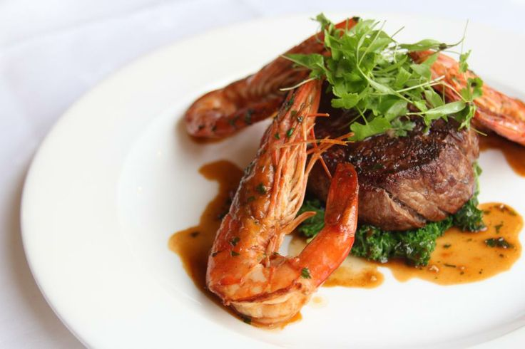Fillet of beef & tiger prawns, garlic, chilli & rosemary oil, house cut chips.