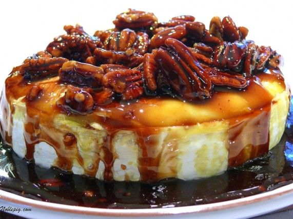 Kahlua-Pecan-Brown Sugar Baked Brie from NoblePig.com. The perfect holiday appetizer.