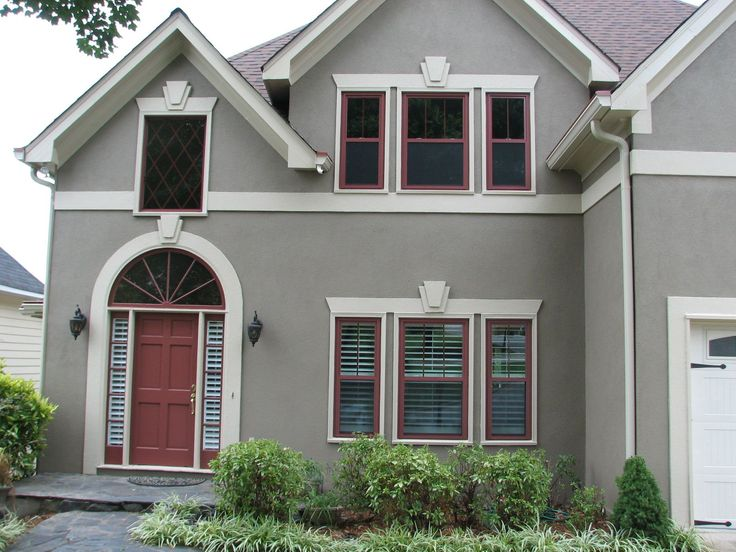 Home Exterior With PVC Window Trims And Grey Walls