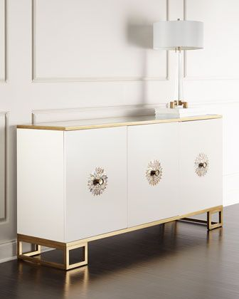"John-Richard Collection Prynne Credenza | Golden eglomise top with golden line detail and beveled edges. Door handle backplates inlaid with mother of pearl. 72.75""W x 21.25""D x 37.5""T. 3 doors; 2 adjustable shelves. Mortise-and-tenon frame construction. 