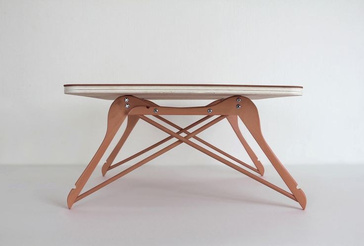 A table with four hangers as a base by Pierre Lota.