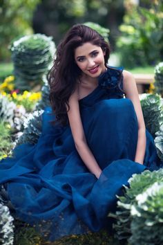 Pakistani Model/actress Mahira Khan looking beautiful in a blue dress.
