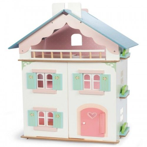 A romantic style painted wooden doll's house with juliette balcony.  Painted in clean white and soft pinks and aquas.  Front windows and shutters can be opened and closed.  Features also include a decorated interior plus removable roof panel for easy play access. 	Dolls and furniture are sold separately.