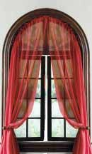 Arched window curtain, achieved with a flexible, clear plastic curtain rod.  For the dining room.