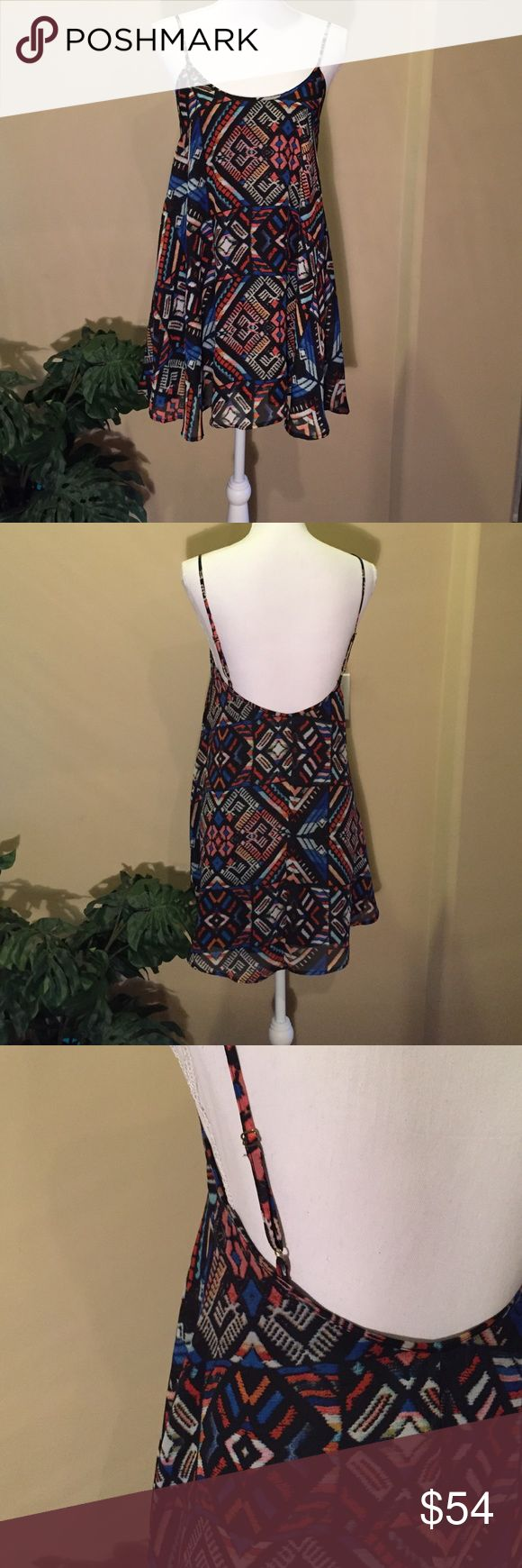 NEW Show Me Your Mumu Guatelala Bella Swing Dress New with tags: Mumu Guatelala Bella Dress with adjustable straps. Beautiful geometric pattern. Wear it as a dress or top. Lengthen the straps and wear it over a bando bra. Adorable. 100% polyester. Fully lined. Show Me Your MuMu Dresses Mini