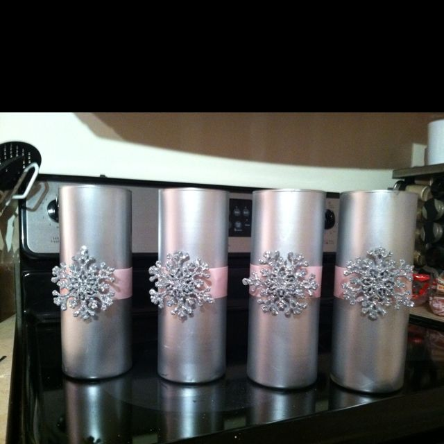 Dollar store vase, silver spray paint, double sided tape, pink ribbon, decorative snowflake. Super easy n elegant! Put flowers in it and it's a perfect centerpiece for a party!