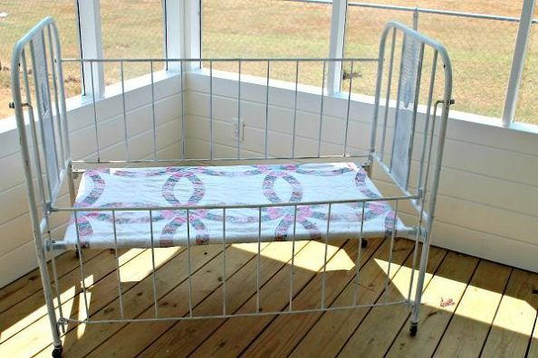 a vintage baby bed turned into a comfy bench, outdoor furniture, porches
