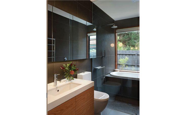 Bathroom with vanity, toilet and built-in bathtub