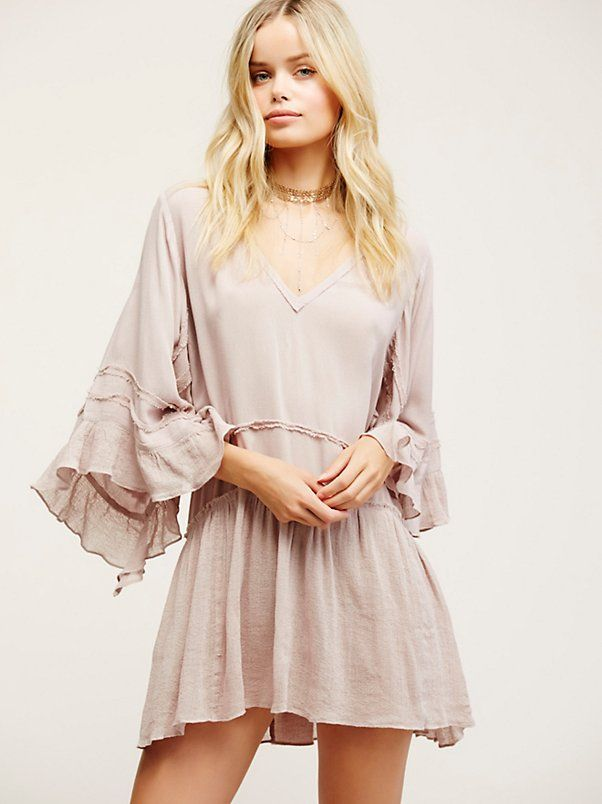 Come What May Tunic | Made from our sheer and gauzy Endless Summer fabric, this pretty tunic features a deep V-neckline and flowy sleeves with dramatic vents and ruffle accents. Raw edges create a cool lived-in look. Throw on top of a bikini or layer over one of our seamless styles for an effortless look.