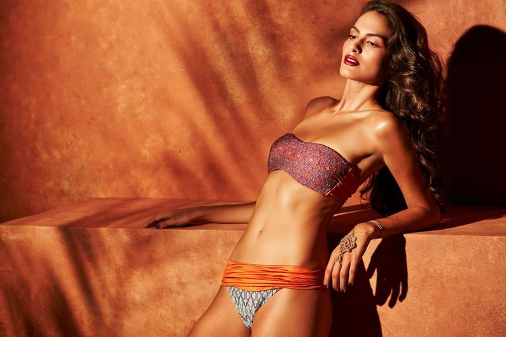 Model is wearing the SAMAL bandeau in Rusty Orange and hand-embroidered silk accessory on her hand  #mitoswimwear #mitos #bandeau #summer #sea #beach #moroccan #mosaic #model #campaign