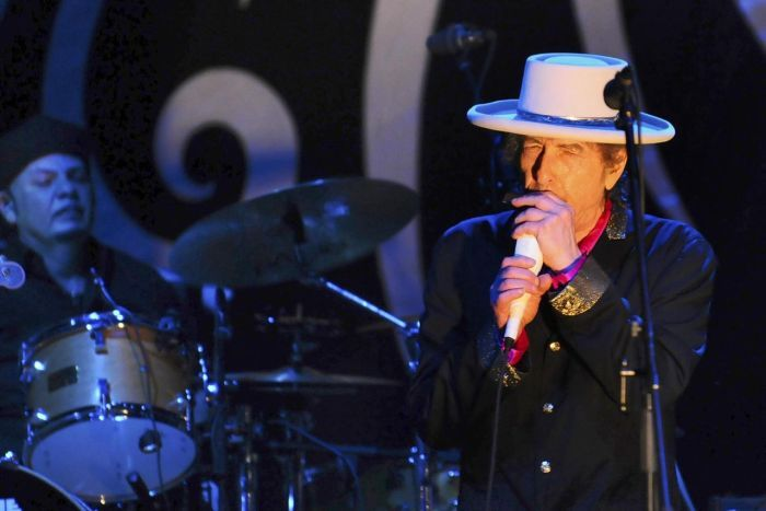 """The White House has announced US folk singer Bob Dylan will be honoured with the country's highest civilian award. The 70-year-old will be awarded the Presidential Medal of Freedom by president Barack Obama in a ceremony next month.  The White House says Dylan was chosen because of his contribution to American culture and to the civil rights movement of the 1960s.  """"These extraordinary honourees come from different backgrounds and different walks of life, but each of them ... Read at ABC…"""