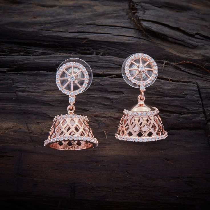 Beautifully Designed CZ Zircon Jhumka earrings studded with synthetic stones, with gold Polish.