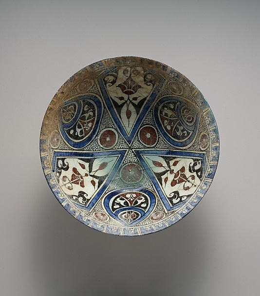 Bowl Date: late 12th–early 13th century Geography: Syria, probably Damascus Medium: Stonepaste; polychrome-painted under transparent glaze Dimensions: Diam. 8 7/8 in. (22.5 cm) H. 4 1/8 in. (10.5 cm) Classification: Ceramics Credit Line: H.O. Havemeyer Collection, Gift of Horace Havemeyer, 1941 Accession Number: 41.165.2 Met Museum