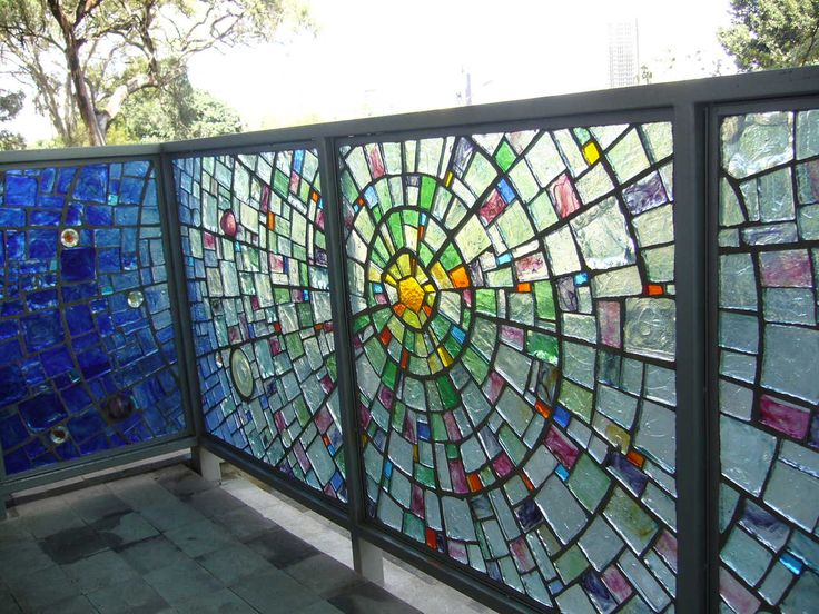 stained glass railing and gate by Kitengela Glass, run by  Nani Croze, German artist and community activist.