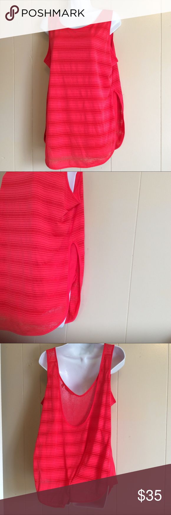 Size Large Athleta loose tank top striped coral Only tried on, like new coral monotone striped loose tank top. Very light fabric two layers. Tunic style bottom a little longer than a regular top. Size Large athleta Athleta Tops