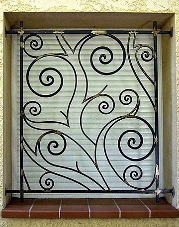 wrought+iron+art+windows | Our wrought iron creations - Protection grilles