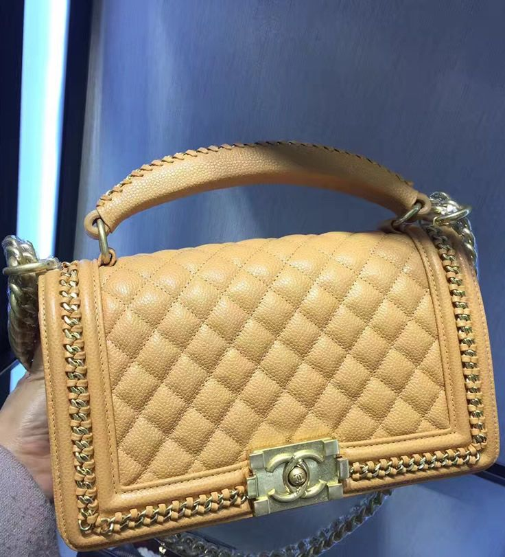 The chain is implemented in order to increase the grip of a handle and to protect the edges from damages.  Find more fabulous handbags at http://www.luxtime.su/