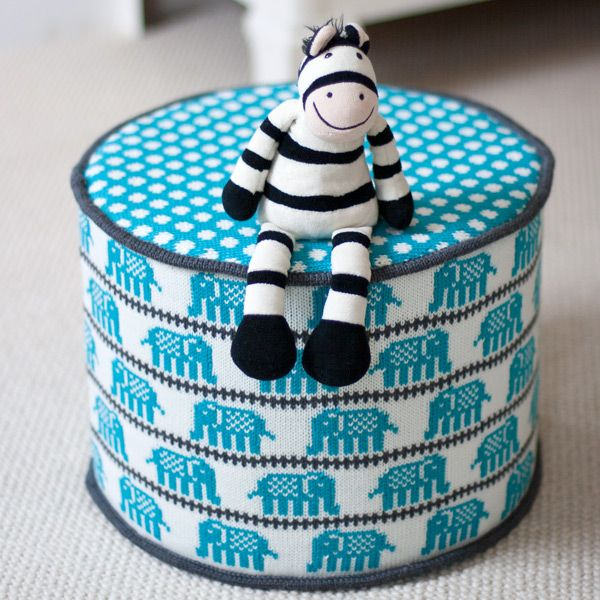 Kids Knitted Pouffe - Elephants in Turquoise. In gorgeous turquoise this child's pouffe or pouf makes a nice child's gift & it's big enough to keep them going through toddlerhood.
