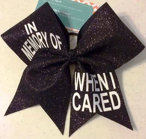 Bows by April - In Memory of When I Cared  Black Glitter Cheer Bow, $17.00 (http://www.bowsbyapril.com/in-memory-of-when-i-cared-black-glitter-cheer-bow/)