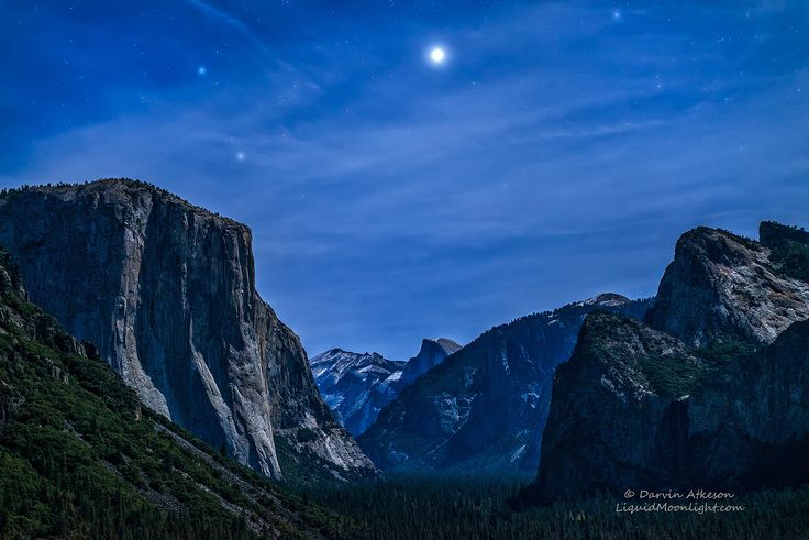 Jupiter Rising - Yosemite National Park by Darvin Atkeson on 500px. Magically high clouds above Yosemite National Park cause large rings to form around the stars as the planet Jupiter rises above Yosemite Valley creating a alien view. At first glance you might mistake the large planet for the moon but no, it is Jupiter rising above Yosemite Valley as the moon serves to illuminate the granite cliffs of El Capitan and Bridal Veil.