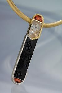 Pendant with 35 carat black drusy onyx, rutilated quartz, and mandarin garnet by Mark Schneider, Schneider Design Studio, Long Beach, California.