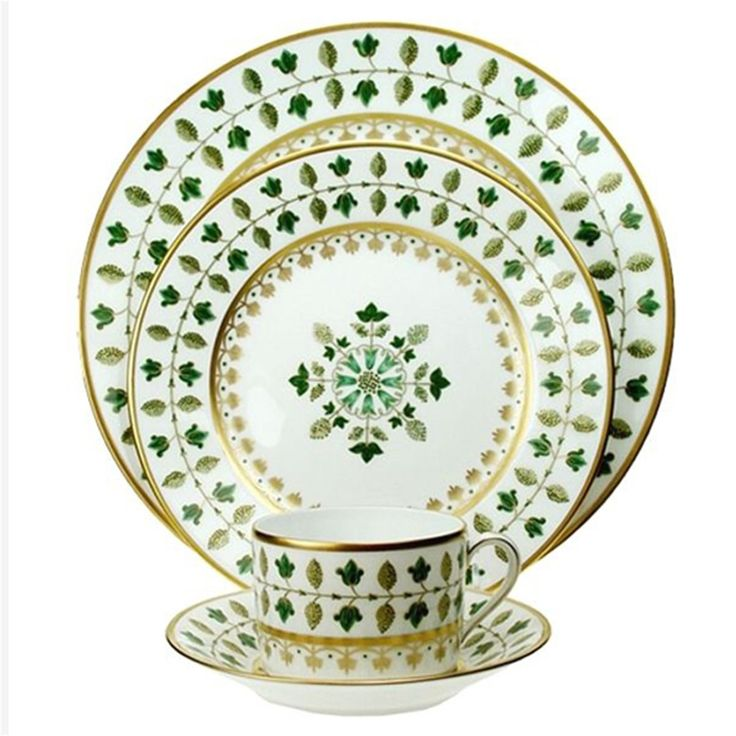 A pattern specially ordered by Madame Chirac for the French Prime Minister's residence, based on a design for the Sèvres Museum. The green-colored foliage outlined in gold is inspired by the lush Matignon gardens.