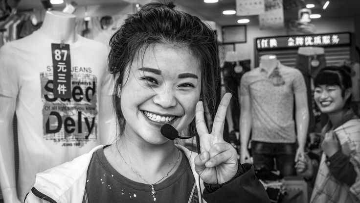 Keep Calm and Sell jeans… It may not be what Churchill had in mind, however it seems Winston's V for victory is the reflex actions of many Chinese when i photography them. Somewhere in the Neighbourhood, Shanghai. Friday, 3rd June, 2016. Photography Wil Graham