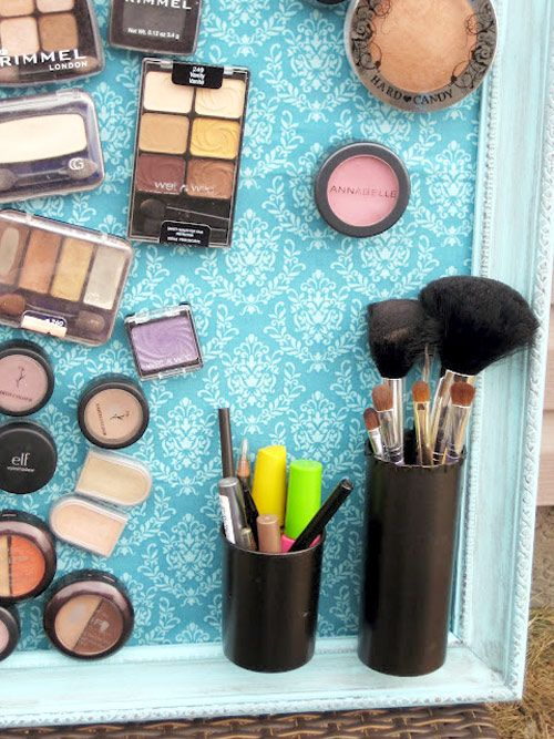 Creating this magnetic makeup board is as easy as fitting a piece of metal in a frame and covering it with fabric or sturdy wallpaper to blend with your decor, gluing small magnets onto the back of your stuff and onto a small cup to hold tools, and arranging everything artfully. You can also use a metal cookie sheet or vintage metal serving tray.