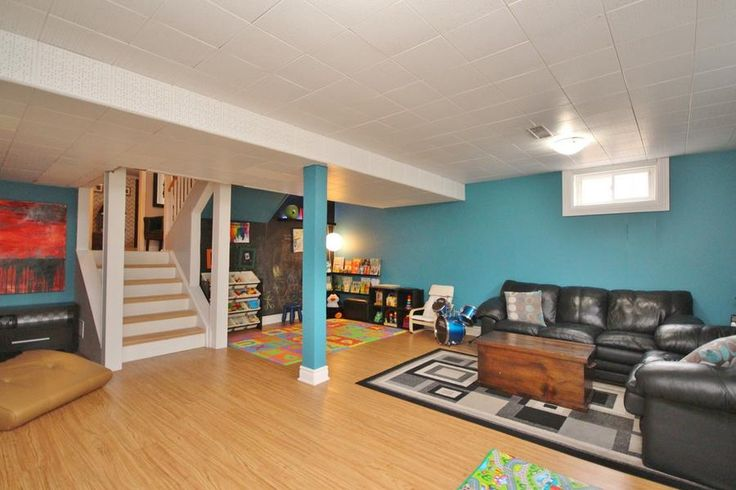 Great finished basement with reading nook, play area with chalkboard wall, living space and fireplace.
