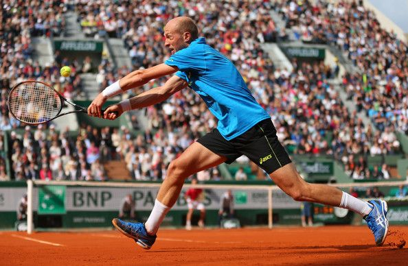 Nikolay Davydenko Nikolay Davydenko of Russian Federation plays a backhand during his Mens Singles match against Richard Gasquet of France on day seven of the French Open at Roland Garros on June 1, 2013 in Paris, France.