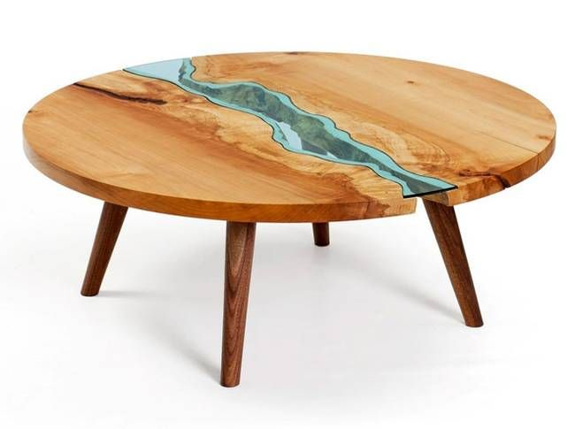 It's a geography lesson of lakes and rivers handcrafted for the living room -- gorgeous tables made with once-rotting wood, fitted with embedded pieces of handcut blue glass.