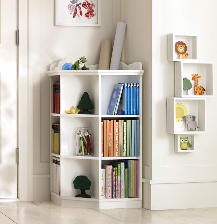 Perfect for an awkward corner, this bookcase will keep any playroom organized. HomeDecorators.com