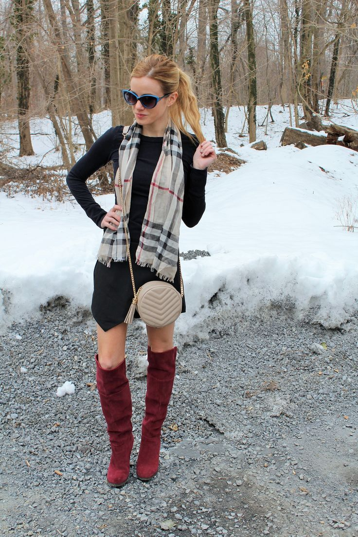 Shop this look on Lookastic:  http://lookastic.com/women/looks/crossbody-bag-scarf-sweater-dress-sunglasses-knee-high-boots/9140  — Beige Leather Crossbody Bag  — Beige Plaid Scarf  — Black Sweater Dress  — Blue Sunglasses  — Burgundy Suede Knee High Boots