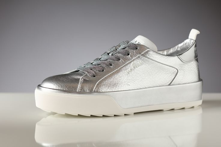 Sleek style in silver sneakers by Hogan for her!