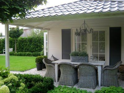 covered porch, chairs, and table  would be such a serene yard....