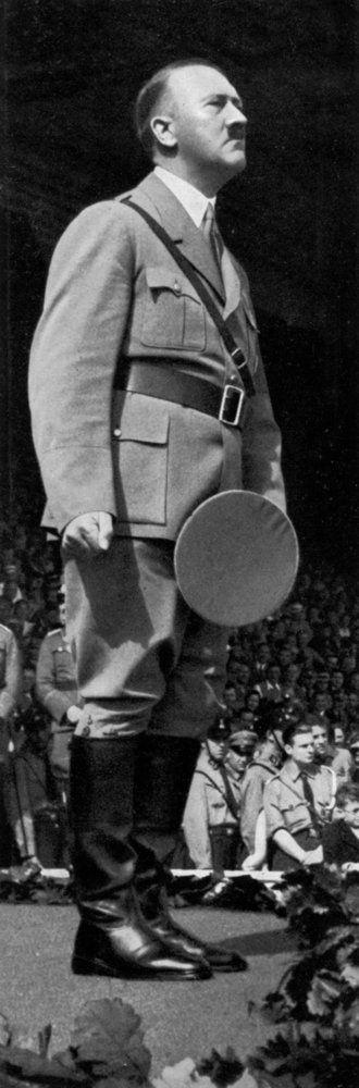 Adolf Hitler at the Nuremberg Rally, Germany..... Borotvált arc, gyűrött sapka. Nem ügyelt a részletekre.