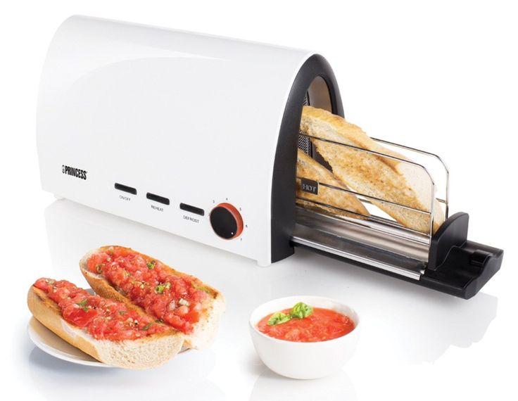 Tostadora en forma de tunel que permite guardar el calor del pan, dentro de la tostadora. Marca Princess.