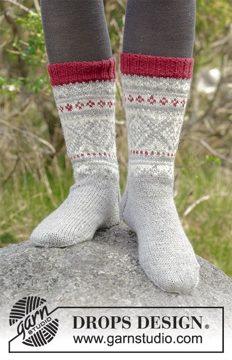Narvik Socks / DROPS 183-4 - Knitted socks with multi-coloured Norwegian pattern. Sizes 35-46. The piece is worked in DROPS Karisma.