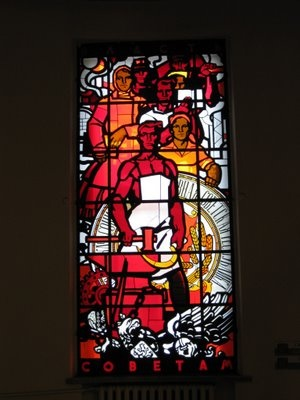Stain glass window that once was in the Museum of Communism in St. Petersburg.  The text says: Women in the Soviet Union have the same rights as men.