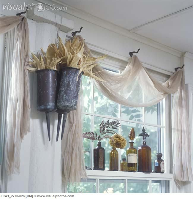 Vintage window treatment ideas this one from visual for Unique window designs