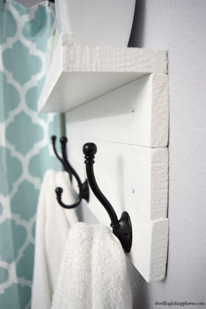 Upgrade your bathroom from those boring towel bars to this pretty and simple DIY towel rack! It even has a shelf to display all your pretty things!