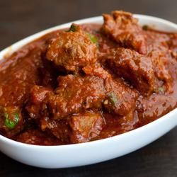 Rogan Josh.  Excellent.  I pulled out cardamom, cinnamon, and bay leaves out before serving.  I used 3lbs of lamb with all other quantities the same.